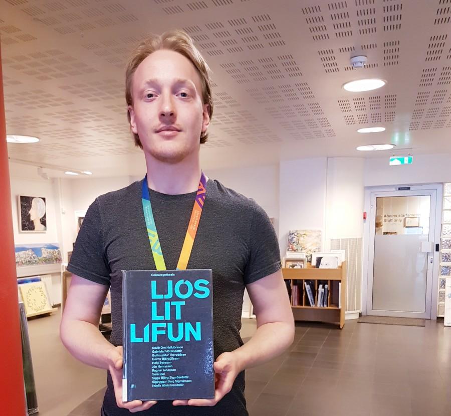Librarian holding an art book